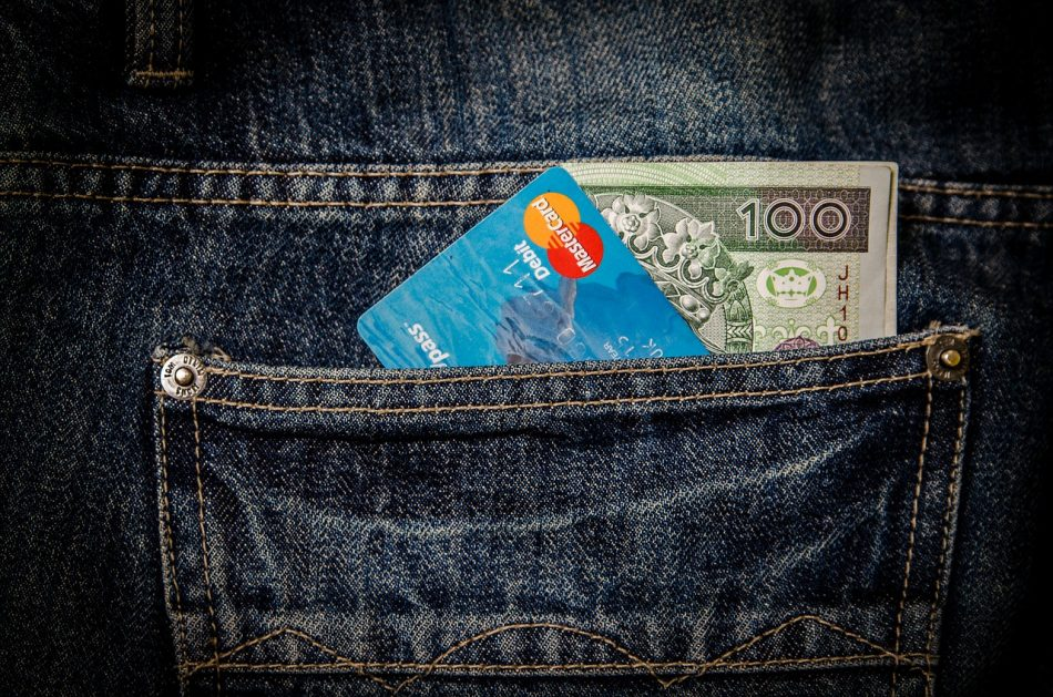 Credit card and money in Jean pocket